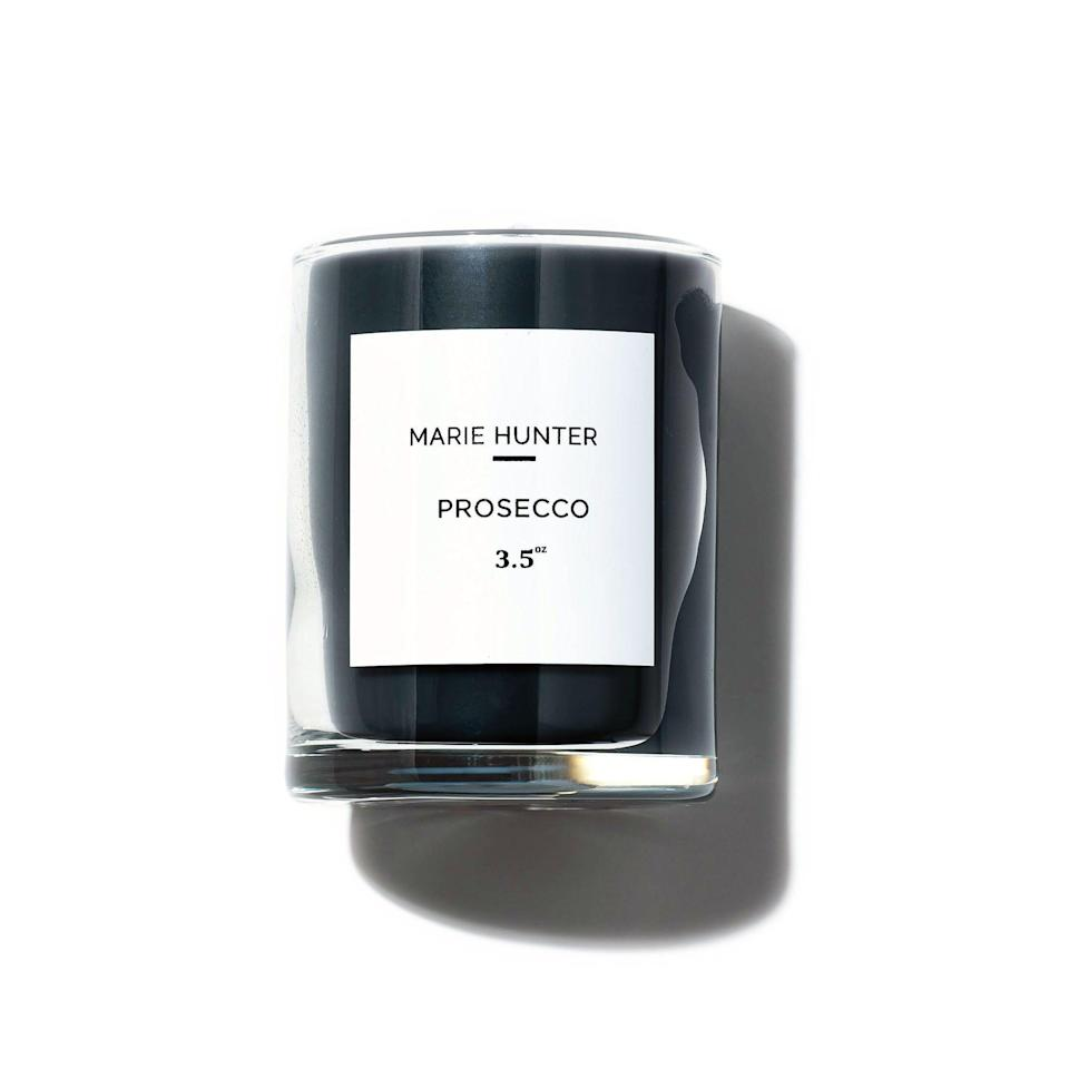 "<p><strong>Marie Hunter</strong></p><p><strong>$18.00</strong></p><p><a href=""https://www.mariehunterbeauty.com/homefragrance/prosecco-signature-candle-mini?category=Small+Candles"" rel=""nofollow noopener"" target=""_blank"" data-ylk=""slk:SHOP IT"" class=""link rapid-noclick-resp"">SHOP IT</a></p><p>Never met a prosecco candle I didn't like, including this mini one inspired by Marie Hunter Beauty founder KéNisha Ruff's favorite wine.</p>"