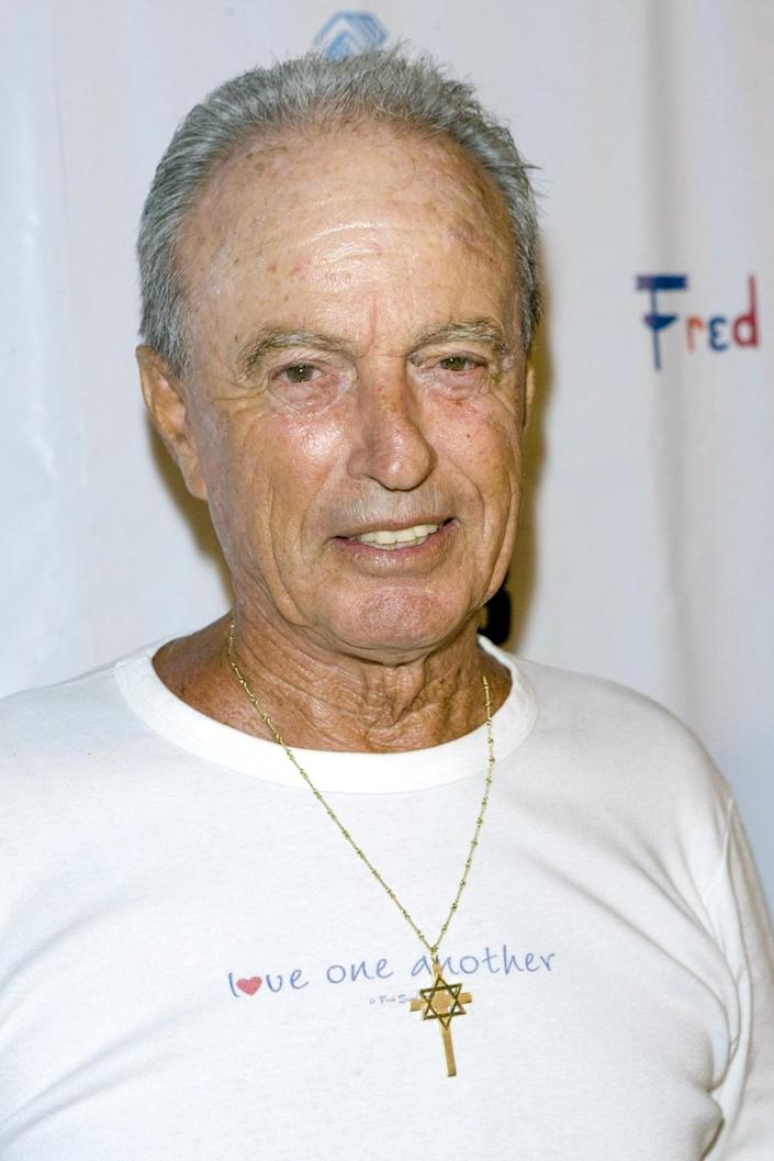 Fred Segal in a white T-shirt