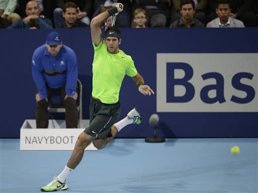Argentina's Juan Martin Del Potro serves a ball to Switzerland's Roger Federer during their final match at the Swiss Indoors tennis tournament at the St. Jakobshalle in Basel, Switzerland, on Sunday, Oct. 28, 2012. (AP Photo/Keystone/Georgios Kefalas)