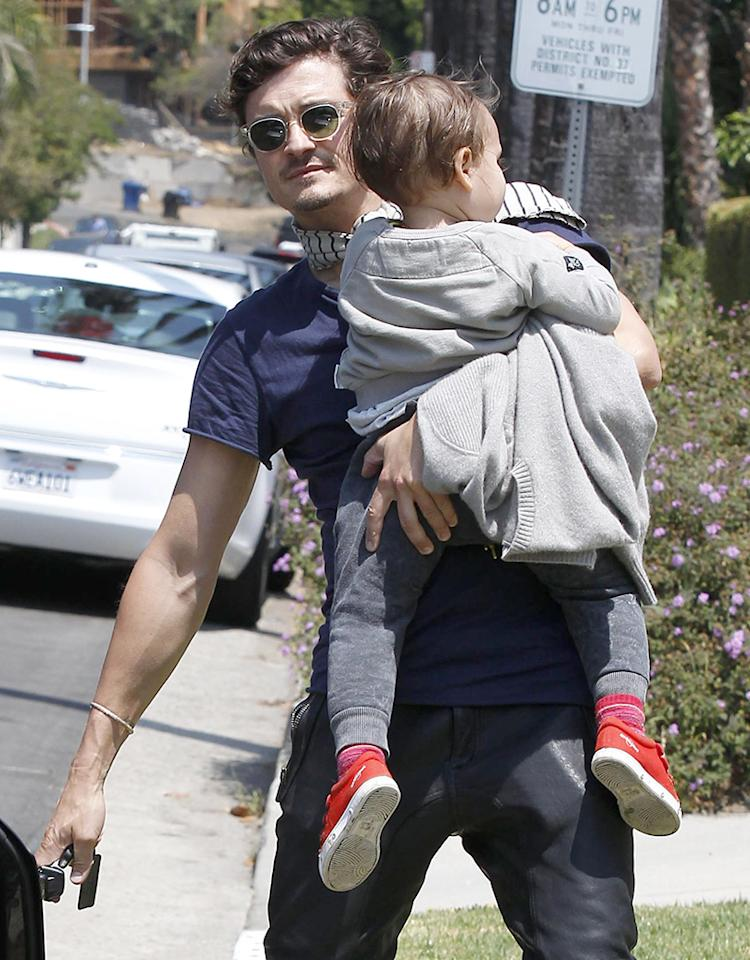 Hunky dad Orlando Bloom gave 2-year-old son Flynn a lift on their way to a friend's house in L.A. on Saturday. And though you can't see his face in this pic, trust us, he's a cutie. How could he not be? He's got Orlando for a dad and model Miranda Kerr for a mom! (5/4/2013)