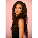 """We always knew mermaid hair was possible, but this is beyond. Supermodel Joan Smalls is serving major almost-waist-length layered ringlets that fittingly frame her face. Can you imagine how epic a hair flip Boomerang would be? """"This long layered haircut is great for those with loose curls and waves who want movement without sacrificing length,"""" says Riley. To get the look, her technique would be to vertically piece sections of hair all around the head, elevating 45 degrees to the desired length, and cutting layers with a pair of shears."""