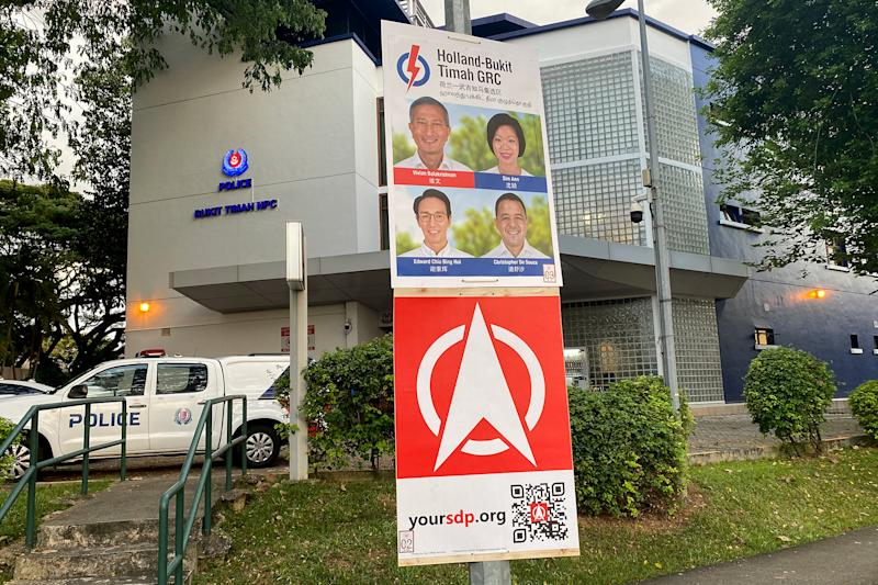 Election posters from the People's Action Party and Singapore Democratic Party seen hanging in the Bukit Timah area. Both parties will be facing off in the electoral fight for Holland-Bukit Timah GRC. (PHOTO: Dhany Osman / Yahoo News Singapore)