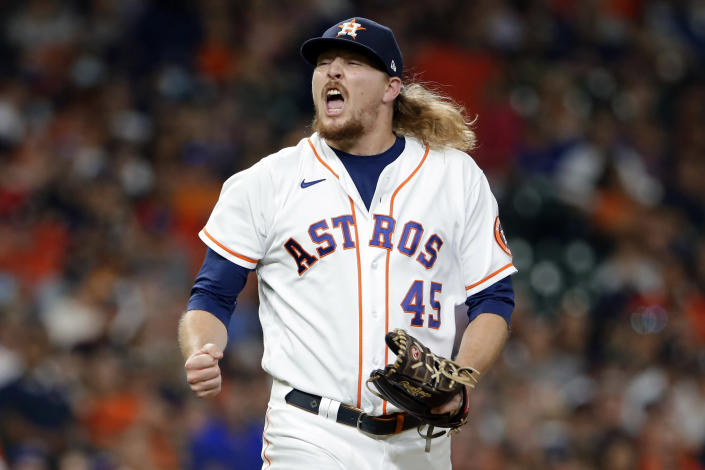 Houston Astros relief pitcher Ryne Stanek reacts after striking out Texas Rangers' Nate Lowe during the eighth inning of a baseball game Saturday, July 24, 2021, in Houston. After allowing a lead-off single, Stanek struck out the next three batters. (AP Photo/Michael Wyke)