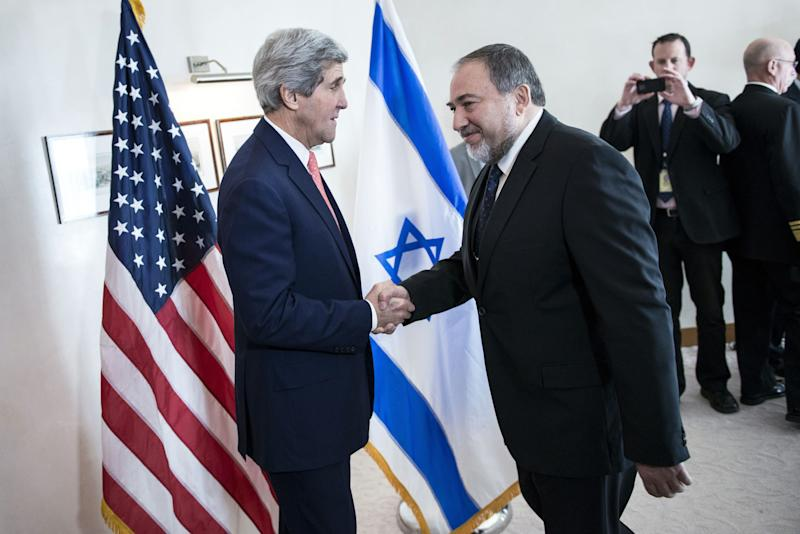 Israeli Foreign Minister Avigdor Lieberman, right, shakes hands with U.S. Secretary of State John Kerry, ahead of their meeting at the David Citadel hotel in Jerusalem, Friday, Jan. 3, 2013. (AP Photo/Brendan Smialowski, Pool)