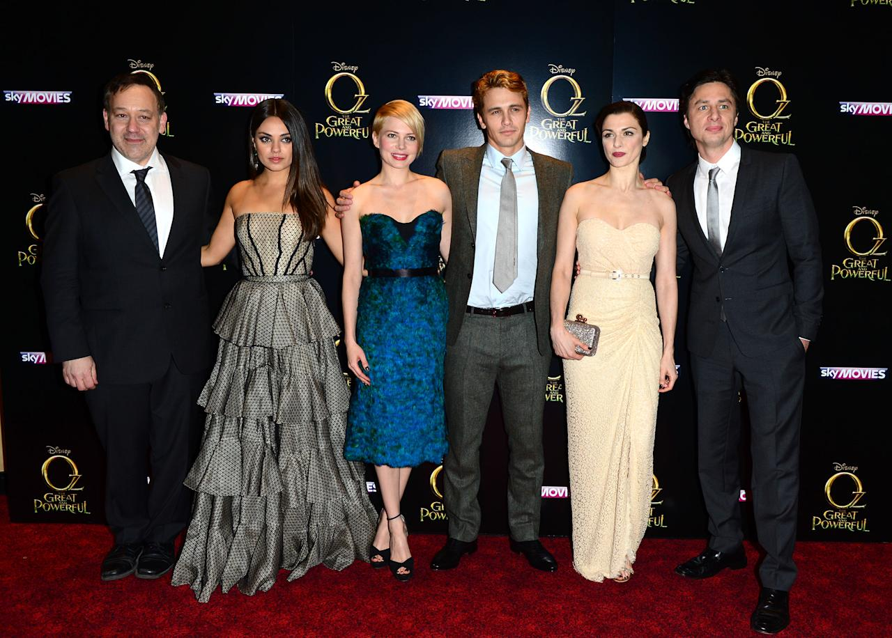 Sam Raimi, Mila Kunis, Michelle Williams, James Franco, Rachel Weisz and Zach Braff attend Walt Disney Pictures European Premiere of 'Oz: The Great And Powerful' at the Empire Leicester Square in London on Thursday, Feb. 28, 2013. (Jon Furniss/Invision for Disney/AP)