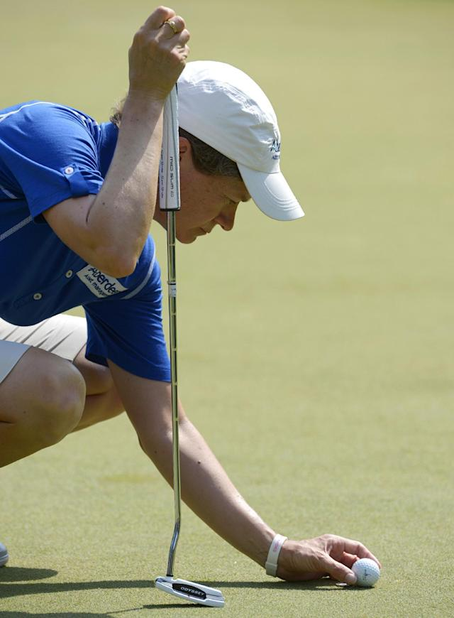 Catriona Matthew, of Scotland, places her ball before putting on the eighth hole in the second round of the Airbus LPGA Classic golf tournament at Magnolia Grove on Friday, May 23, 2014, in Mobile, Ala. (AP Photo/G.M. Andrews)