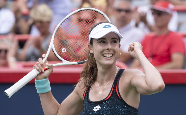 Elize Cornet, of France, celebrates her victory over Angelique Kerber, of Germany, at the Rogers Cup women's tennis tournament, Wednesday, Aug. 8, 2018, in Montreal. (Paul Chiasson/The Canadian Press via AP)