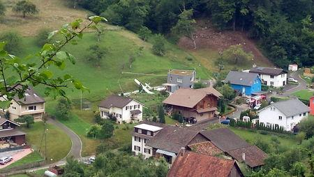 One of two planes which crashed during an air show is seen in the village of Dittingen, Switzerland, in this handout photo provided by Kantonspolizei Basel Landschaft on August 23, 2015. REUTERS/Kantonspolizei Basel Landschaft/Handout via Reuters