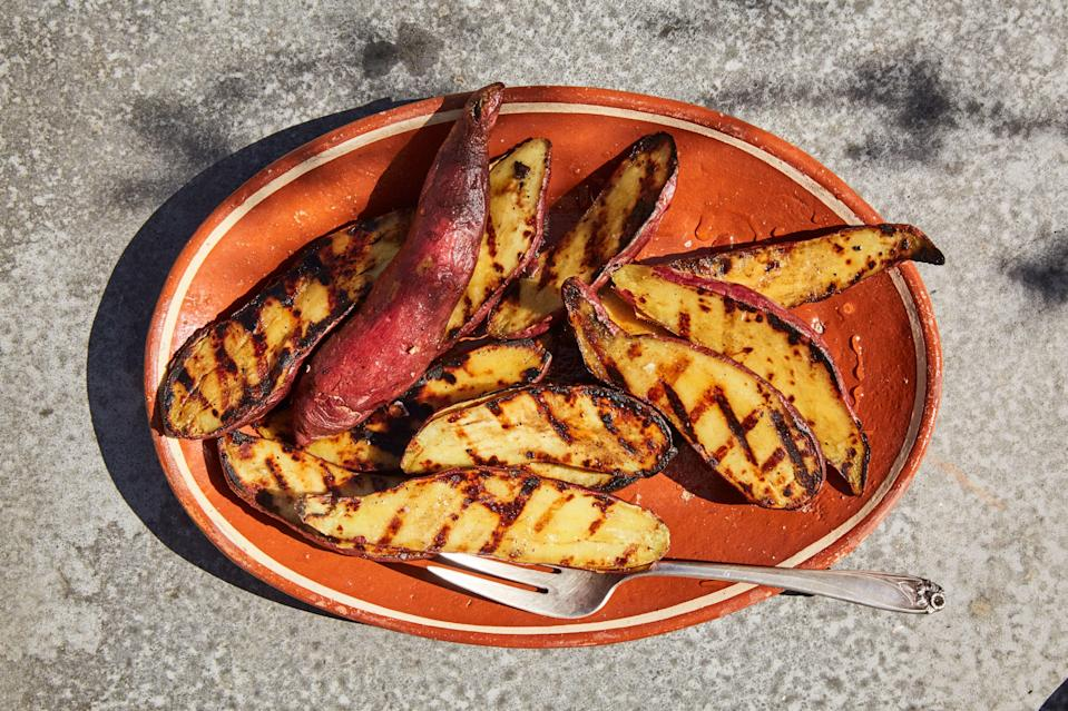 """The smart move here: You'll steam these Japanese sweet potatoes before throwing them on the grill, so you get moist, creamy interiors and a touch of <a href=""""https://www.epicurious.com/expert-advice/burn-your-dinner-on-purpose-article?mbid=synd_yahoo_rss"""" rel=""""nofollow noopener"""" target=""""_blank"""" data-ylk=""""slk:char"""" class=""""link rapid-noclick-resp"""">char</a>. <a href=""""https://www.epicurious.com/recipes/food/views/charred-sweet-potatoes-with-honey-and-olive-oil?mbid=synd_yahoo_rss"""" rel=""""nofollow noopener"""" target=""""_blank"""" data-ylk=""""slk:See recipe."""" class=""""link rapid-noclick-resp"""">See recipe.</a>"""