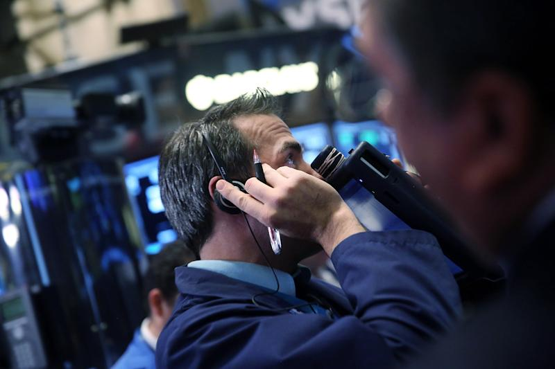 A trader works on the floor of the New York Stock Exchange (NYSE) on November 18, 2014