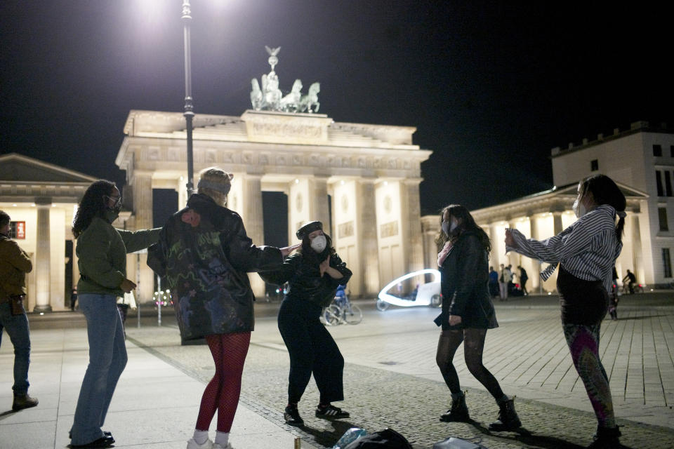 Women dance to celebrate the victory of President-elect Joe Biden and Vice President-elect Kamala Harris in front of the Brandenbug Gate next to the United States embassy in Berlin, Germany, Saturday, Nov. 7, 2020. Biden defeated President Donald Trump to become the 46th president of the United States on Saturday, positioning himself to lead a nation gripped by the historic pandemic and a confluence of economic and social turmoil. (Photo/Markus Schreiber)