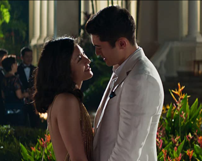 <p>Constance Wu portrays Rachel, an economics professor at NYU, who is stunned to learn that her boyfriend's family is one of the richest in Singapore. Even though it's a hilarious comedy, the love between Rachel and Nick, portrayed by Henry Golding, is the foundation that makes everything work. Nick is planning to propose, despite his family's belief that Rachel is not good enough for him. Cue: the big romantic gesture. Nick proposes and is willing to leave his family to be with Rachel. But she declines because she didn't want to ruin his family. Nick proposes against the airport, this time with his mother's blessing. Rachel accepts and they celebrate with Nick's family.</p>