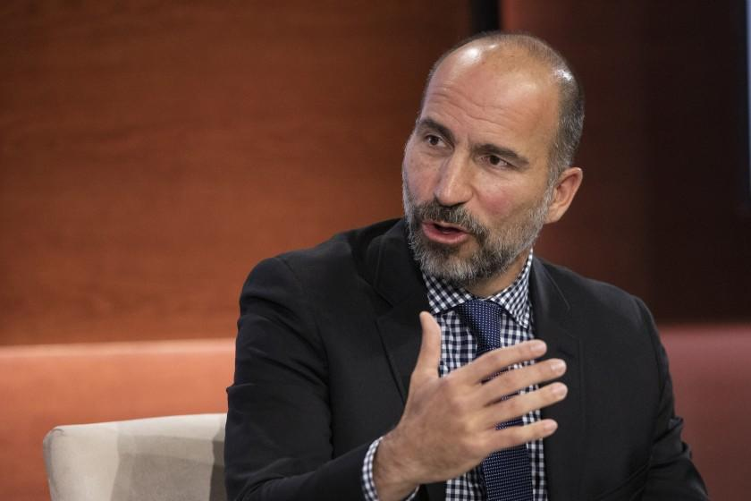 """FILE - In this Wednesday, Sept. 25, 2019, file photo Dara Khosrowshahi, CEO of Uber, speaks at the Bloomberg Global Business Forum in New York. Uber will begin cramming more services into its ride-hailing app as it explores ways to generate more revenue and finally turn a profit. The makeover announced Thursday, Sept. 26, will include force-feeding its food delivery service, """"Eats,"""" into the Uber app that millions of people use to summon a ride. (AP Photo/Mark Lennihan, File)"""