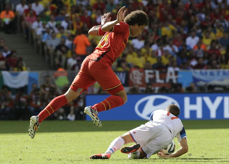 Belgium's Axel Witsel, left, fouls Russia's Oleg Shatov during the group H World Cup soccer match between Belgium and Russia at the Maracana Stadium in Rio de Janeiro, Brazil, Sunday, June 22, 2014