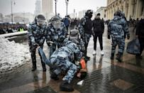 Police detain a man during a rally in support of jailed opposition leader Alexei Navalny in Moscow on Sunday.