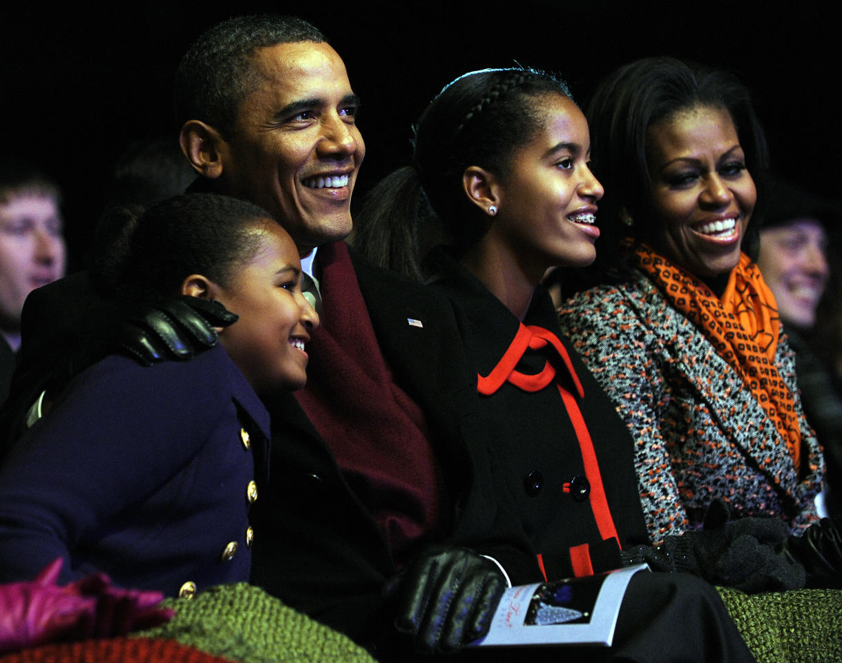 WASHINGTON, DC - DECEMBER 01: (AFP OUT)  U.S. President Barack Obama (C) and daughters Sasha (2nd L), Malia (2nd R) and first lady Michelle Obama (R) participate in the 2011 National Christmas Tree Lighting on December 1, 2011 at the Ellipse, south of the White House, in Washington, DC. The first family participated in the 89th annual National Christmas Tree Lighting Ceremony.  (Photo by Roger L. Wollenberg-Pool/Getty Images)