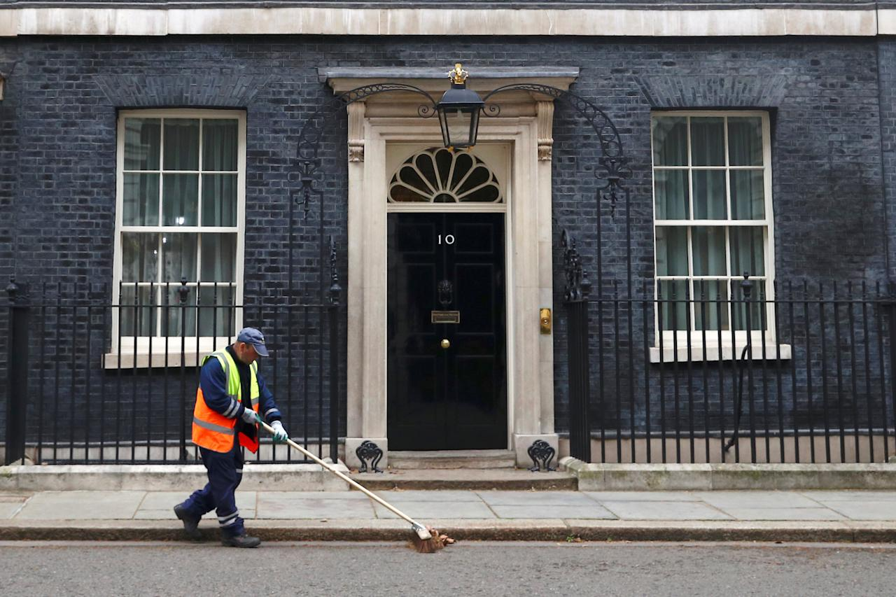 A road sweeper cleans up outside Number 10 Downing Street in London, Britain March 20, 2019. REUTERS/Hannah McKay