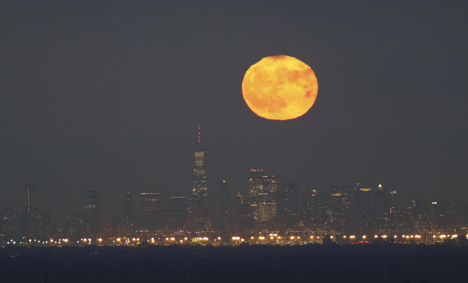 The full blue moon rise behind One World Trade Center in New York City on Halloween on October 31, 2020. (Photo by: Getty)