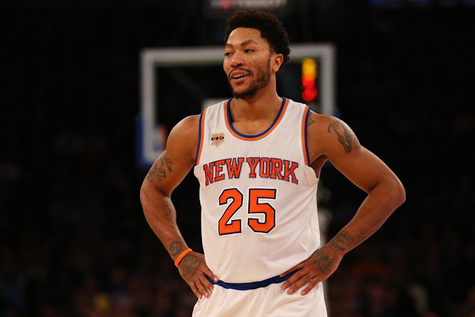 Derrick Rose with his hands on his hips.