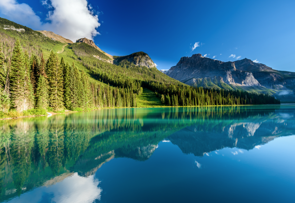 """<p>Home to the most legendary mountainscapes in North America, the district of British Columbia, Canada contains incomparable natural beauty–including a portion of the Rocky Mountains. The peaks here glisten with snow, the river water runs transparent, and the wildlife is endlessly bountiful. </p><p>While there's no shortage of Canadian National Parks, the Rocky Mountains provide one of the most quintessential and best views in the world. <a href=""""https://wildretreat.com/"""" rel=""""nofollow noopener"""" target=""""_blank"""" data-ylk=""""slk:Clayoquot Wilderness Retreat,"""" class=""""link rapid-noclick-resp"""">Clayoquot Wilderness Retreat,</a> located on Vancouver Island and the Bedwell River, is the epitome of luxury in unison with nature. The property is enclosed riverside by lush forest, broad mountain ranges, families of black bears, and natural hot springs– and all visible from this special retreat.</p>"""