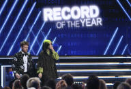 "Finneas O'Connell, left, and Billie Eilish are seen in the audience before accepting the award for record of the year for ""Bad Guy"" at the 62nd annual Grammy Awards on Sunday, Jan. 26, 2020, in Los Angeles. (Photo by Matt Sayles/Invision/AP)"