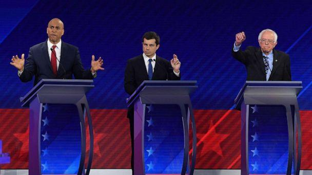 PHOTO: Democratic presidential hopefuls Cory Booker, Pete Buttigieg and Sen. Bernie Sanders gesture during the third Democratic primary debate of the 2020 presidential campaign season in Houston, Sept. 12, 2019. (Robyn Beck/AFP/Getty Images)