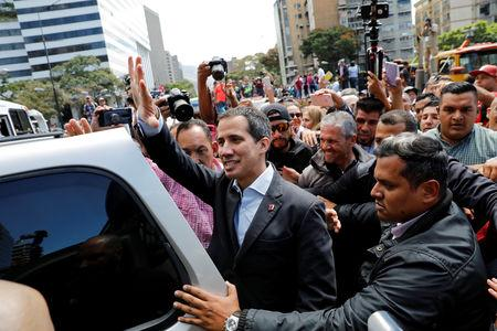 Venezuela's opposition leader Juan Guaido, who many nations have recognized as the country's rightful interim ruler, attends a protest of the public transport sector against the government of Venezuela's President Nicolas Maduro in Caracas, Venezuela February 20, 2019. REUTERS/Andres Martinez Casares
