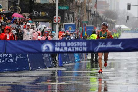 Yuki Kawauchi of Japan comes down Boylston Street to the finish line to win the men's race of the 122nd Boston Marathon in Boston, Massachusetts, U.S., April 16, 2018. REUTERS/Brian Snyder