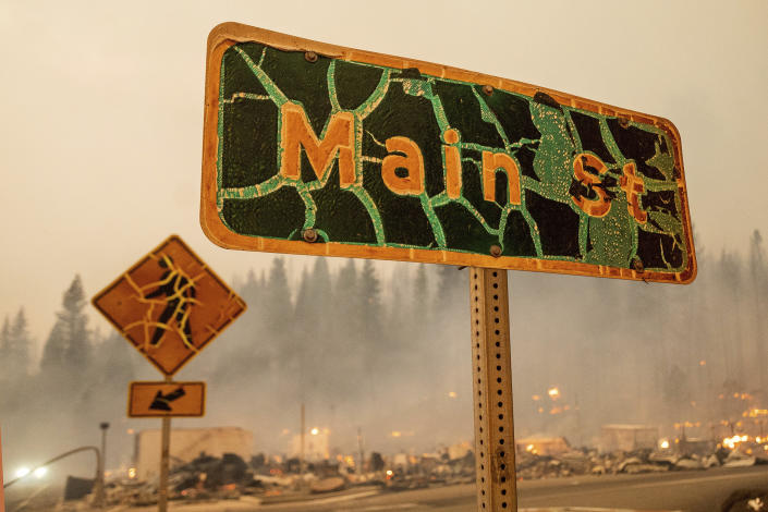 A street sign stands in central Greenville as the Dixie Fire tears through Plumas County, Calif., on Wednesday, Aug. 4, 2021. (Noah Berger/AP)