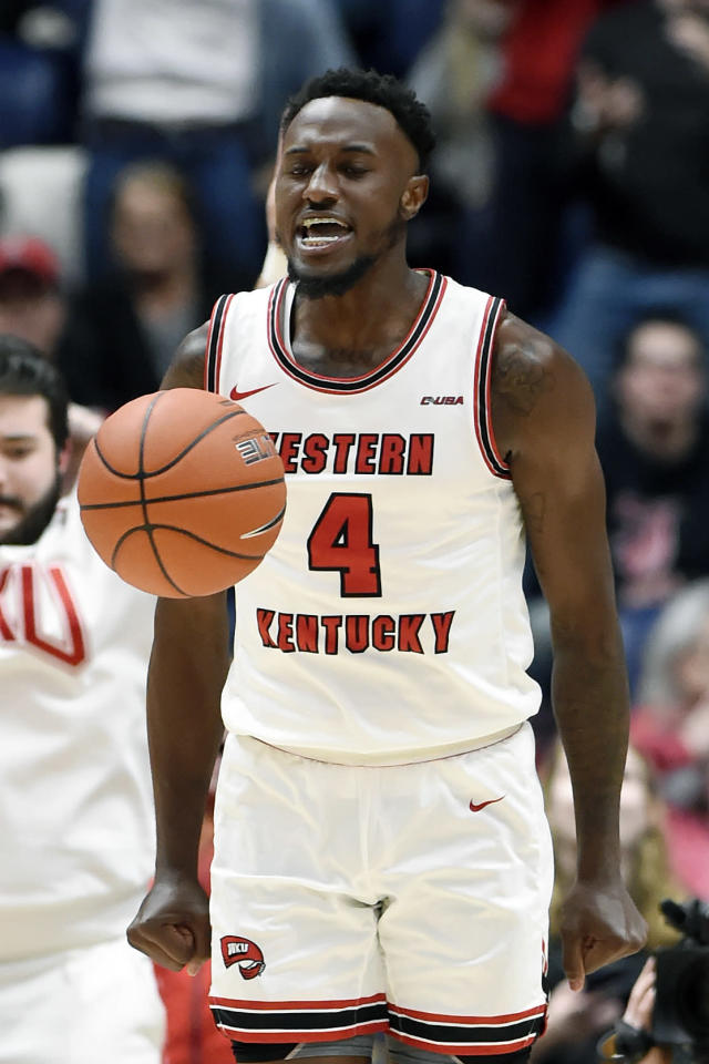 Western Kentucky guard Josh Anderson (4) reacts after making a basket against Louisville during the second half of an NCAA college basketball game Friday, Nov. 29, 2019, in Nashville, Tenn. (AP Photo/Mark Zaleski)