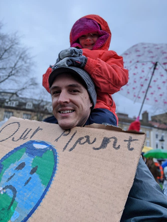 Jon Usher and his five-year-old daughter at Friday's climate march (Jon Usher)