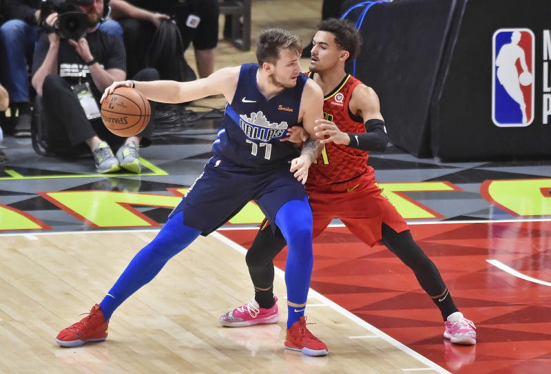 ATLANTA, GA - OCTOBER 24: Atlanta Hawks guard Trae Young (right) defends Dallas Mavericks guard Luka Doncic (left) during the third quarter of a NBA game on October 24, 2018 at State Farm Arena in Atlanta, GA. (Photo by Austin McAfee/Icon Sportswire via Getty Images)