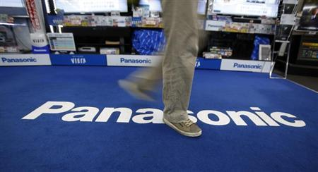 A shopper walks past a Panasonic Corp logo at an electronics retail store in Tokyo