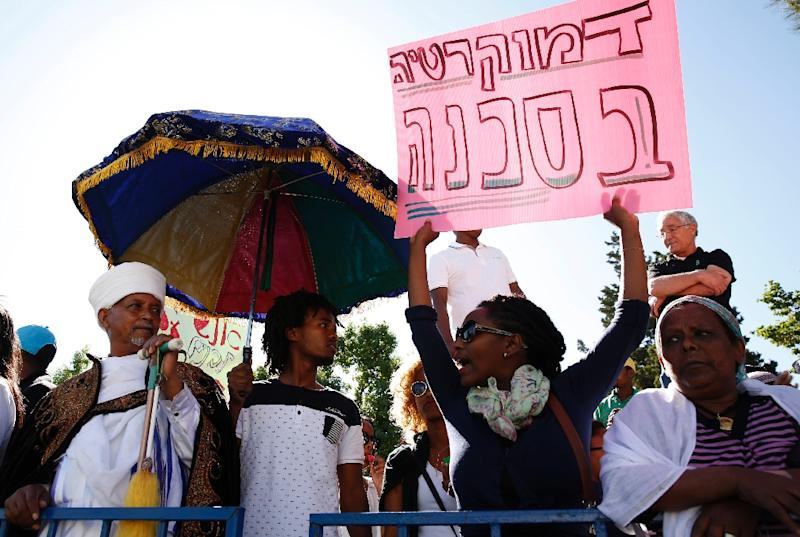 Israelis from the Ethiopian community in Jerusalem take part in a demonstration near a major junction in the city on April 30, 2015 demanding for an investigation into alleged police brutality against Africans living in Israel (AFP Photo/Gali Tibbon)