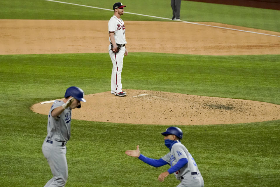 Los Angeles Dodgers' Will Smith (16) celebrates a three-run home run off Atlanta Braves relief pitcher Will Smith during the sixth inning in Game 5 of a baseball National League Championship Series Friday, Oct. 16, 2020, in Arlington, Texas. (AP Photo/Tony Gutierrez)