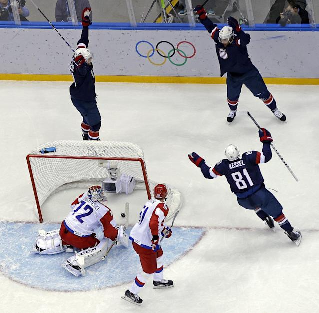 USA defenseman Cam Fowler celebrates after scoring a goal on Russia goaltender Sergei Bobrovski during the second period of a men's ice hockey game at the 2014 Winter Olympics, Saturday, Feb. 15, 2014, in Sochi, Russia. (AP Photo/Mark Humphrey )