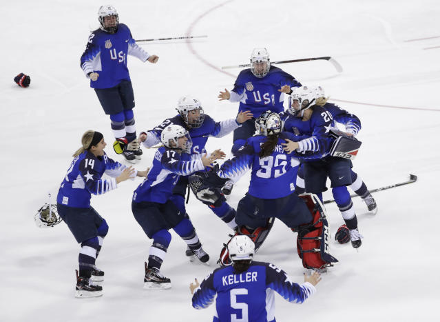 United States celebrates winning gold in the women's gold medal hockey game against Canada at the 2018 Winter Olympics in Gangneung, South Korea, Thursday, Feb. 22, 2018. (AP)
