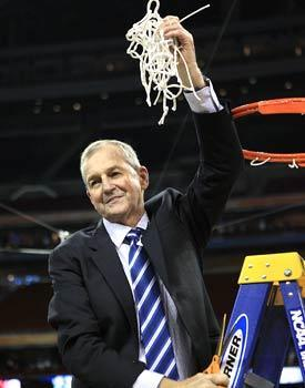 Connecticut coach Jim Calhoun cuts down the net after the Huskies won the 2011 NCAA tournament