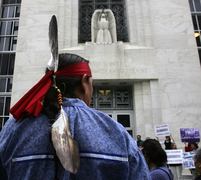 FILE - This Oct. 11, 2007 file photo shows Jake Edward of the Onondaga Council of Chiefs standing outside the federal courthouse in Albany, N.Y., after arguments were heard in the Onondaga Indian Nation's land claim case against New York state. A Native American nation is asking the international community to charge the United States with human rights violations in hopes of getting help with a land claim. The Onondaga Indian Nation says it plans to file a petition at the Organization of American States on Tuesday, seeking human rights violations against the United States government. They want the Inter-American Commission on Human Rights to declare that the U.S. government's decision not to hear their lawsuit asking for the return of 2.5 million acres in upstate New York to be violations of international human rights agreements. (AP Photo/Mike Groll, File)