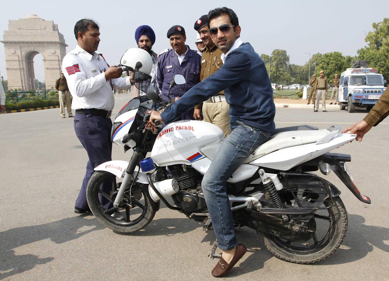 NEW DELHI, INDIA - FEBRUARY 22: Cricketer Gautam Gambhir on bike for road safety awareness program, organised by Delhi Traffic police during Delhi Police week at India Gate Lawn on February 22, 2013 in New Delhi, India. (Photo by Arvind Yadav/Hindustan Times via Getty Images)