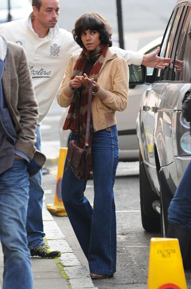 "Halle Berry took a trip back to the 1970s ... via her wardrobe for the new film ""Cloud Atlas."" The 45-year-old beauty was snapped taking part in film's rehearsal in Glasgow, Scotland, on Thursday. Nice bell bottoms! <a href=""http://www.splashnewsonline.com"" target=""new"">Splash News</a> - September 15, 2011"