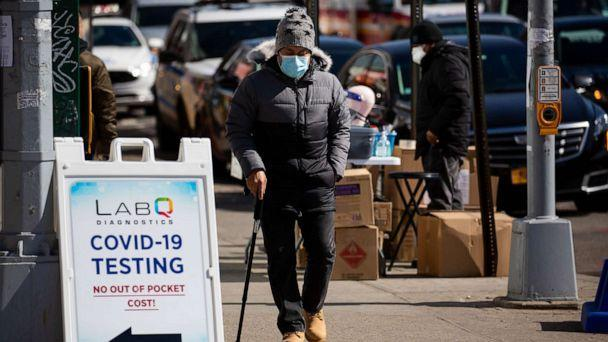 PHOTO: A person wearing a face mask walks past a COVID-19 testing sign in Queens, N.Y., March 8, 2021. (Michael Nagle/Xinhua via Newscom)