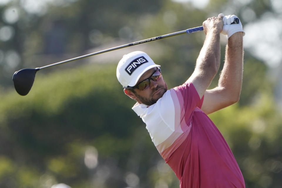 Corey Conners, of Canada, watches his tee shot on the 16th hole during the first round of the PGA Championship golf tournament on the Ocean Course Thursday, May 20, 2021, in Kiawah Island, S.C. (AP Photo/Chris Carlson)