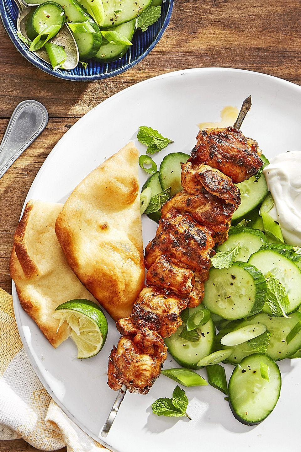 "<p>Cool down Indian-inspired chicken kebabs with a refreshing cucumber and mint salad.</p><p><strong><a href=""https://www.countryliving.com/food-drinks/recipes/a44275/grilled-spiced-chicken-skewers-cucumber-salad-recipe/"" rel=""nofollow noopener"" target=""_blank"" data-ylk=""slk:Get the recipe"" class=""link rapid-noclick-resp"">Get the recipe</a>.</strong></p>"