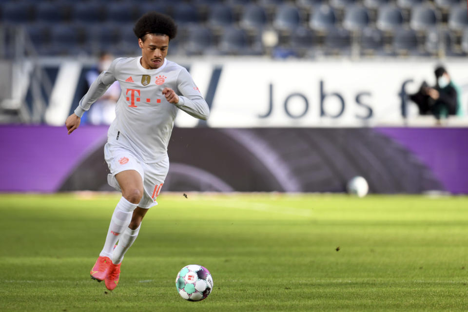 Munich's Leroy Sane controls the ball during the German Bundesliga soccer match between Eintracht Frankfurt and Bayern Munich in Frankfurt, Germany, Saturday, Feb. 20, 2021. (Arne Dedert/POOL via AP)