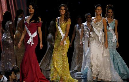 Miss Universe candidates parade in their evening gowns during a preliminary competition in Pasay, Metro Manila, Philippines January 26, 2017. REUTERS/Erik De Castro