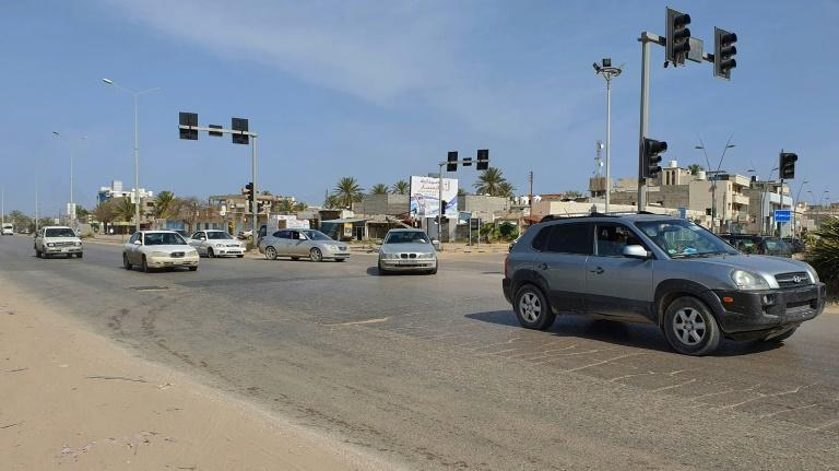 Libyan drivers in Tripoli ignore a curfew aimed at stopping the spread of coronavirus (AFP Photo/Mahmud TURKIA)