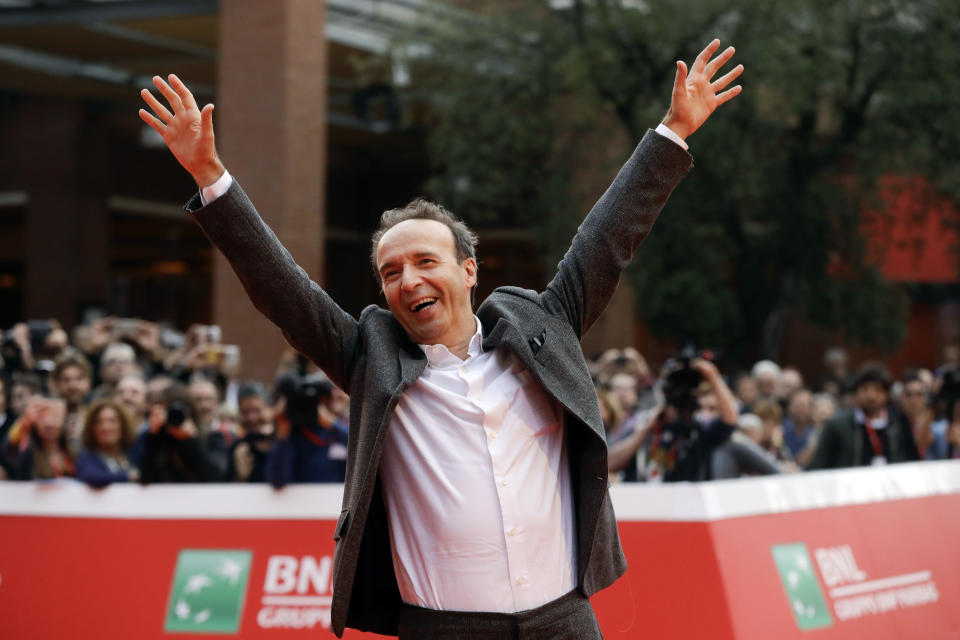 "FILE - In this Sunday, Oct. 23, 2016 filer, Roberto Benigni poses for photographers as he arrives on the red carpet at the Rome Film Festival. The Venice Film Festival said Thursday, April 15, 2021 it will give its lifetime achievement award this year to Oscar-winning director and actor Roberto Benigni. The Golden Lion for Lifetime Achievement is to be awarded at 78th edition of the world's oldest film festival, scheduled for Sept. 1-11 on the Lido. Benigni wrote, directed and starred in ""La Vita e Bella,"" (""Life is Beautiful""), which won the Oscar for best foreign language film, best actor and best musical score in 1999. (AP Photo/Gregorio Borgia, File)"