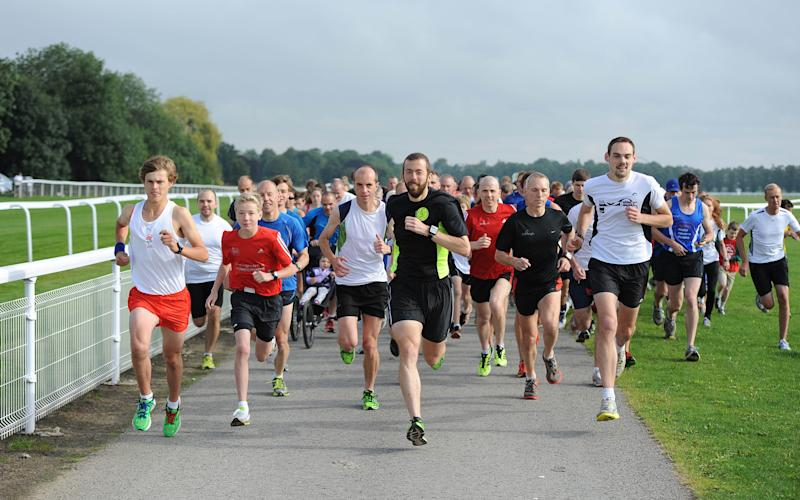 Runners set off at the start of the York Parkrun  - Credit: Asadour Guzelian