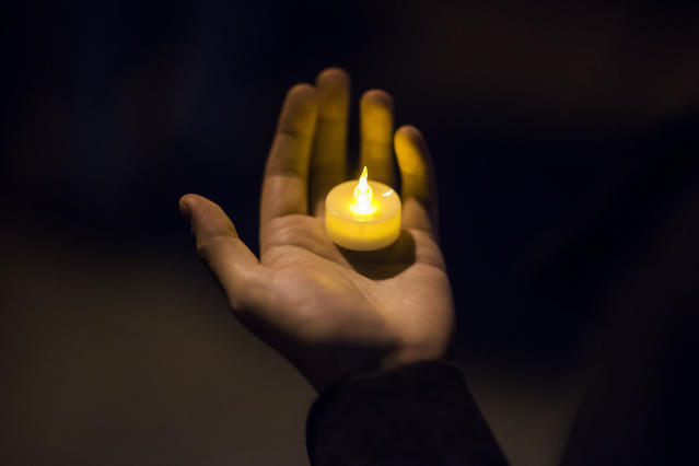 <p>A man holds a candle during an interfaith vigil for peace in response to Manhattan Attack at Foley square, Wednesday, Nov. 1, 2017, in New York. (AP Photo/Andres Kudacki) </p>